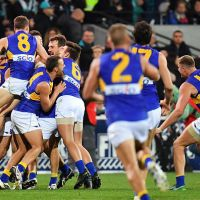 The Eagles players celebrate after the final siren after beating Port Adelaide  on Saturday night. Picture: Daniel Kalisz/Getty Images
