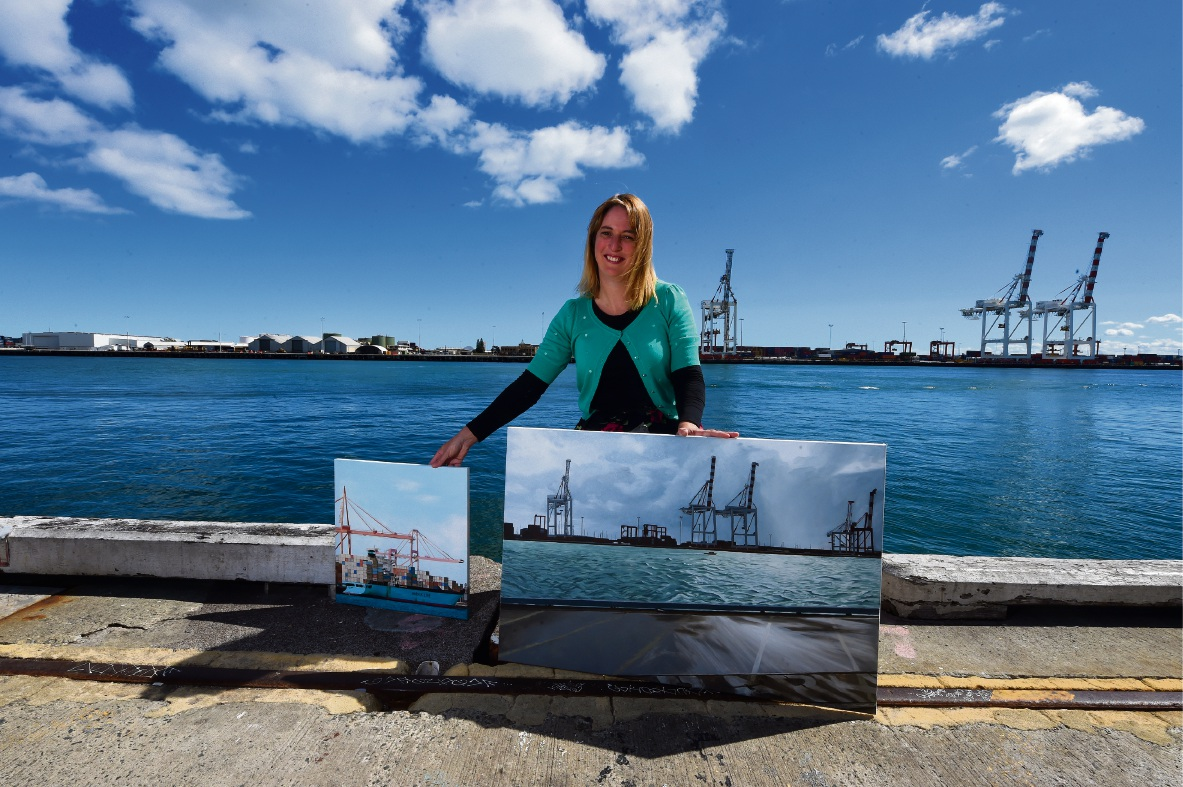Stacy Gardoll with her paintings.