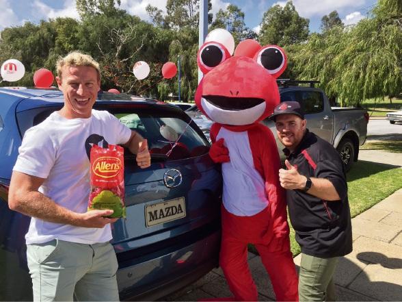 Mazda ambassador Shaun McManus, the Red Frogs Australia mascot, and Red Frogs Australia WA co-ordinator Hayden Glass.