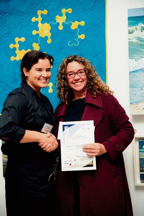 Sahara Du Pont receiving her prize from Swan Hills MLA Jessica Shaw.