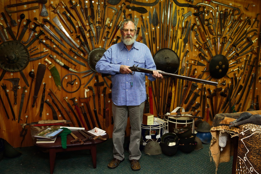 Gun collector Leo Laden, who had to auction his firearms for security reasons, says it's hard to look at the bare walls where they used to hang. Picture: Martin Kennealey