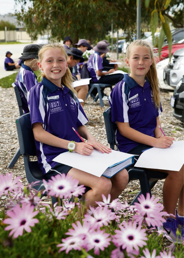 Megan Bell and Jasmin Draper sketching cars while in their outdoor classroom. Picture: Martin Kennealey www.communitypix.com.au   d473433