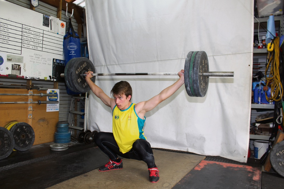 William Saxton snatches 80kg.