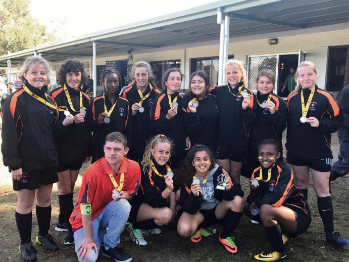 The Peel under-14 girls team with their medals.