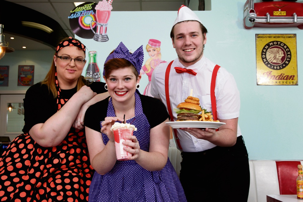 Smiles from staff at DelBoy's Diner: waitress Rebecca Heaward, waitress Ally Hawkins and 'Soda Jerk Boy' Nicholas Buist. Picture: Marie Nirme d474218