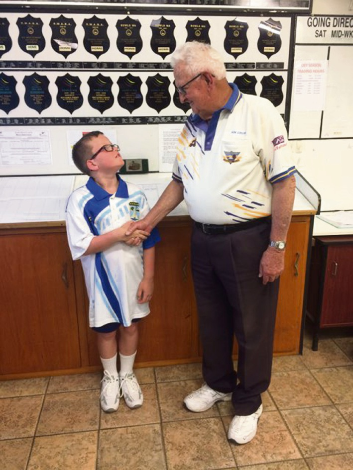 Cockburn Bowls Club's oldest player engages Kwinana's youngest player in friendly game