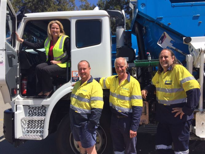 Mayor Marina Vergone checks out one of the new trucks watched by James Dunn, Ralph Baker and Matthew Halliday.