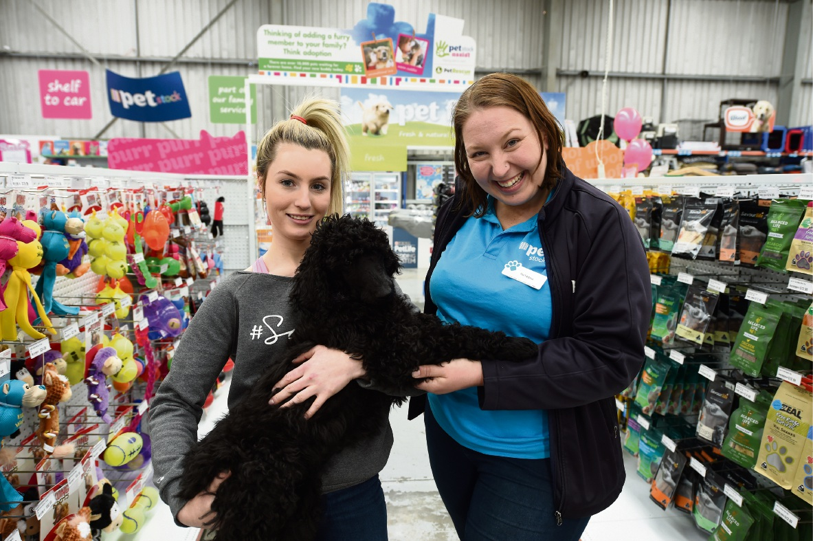 Jenae Griggsby with her poodle Hudson and PETstock manager Natasha McPherson. Picture: Jon Hewson   d474678