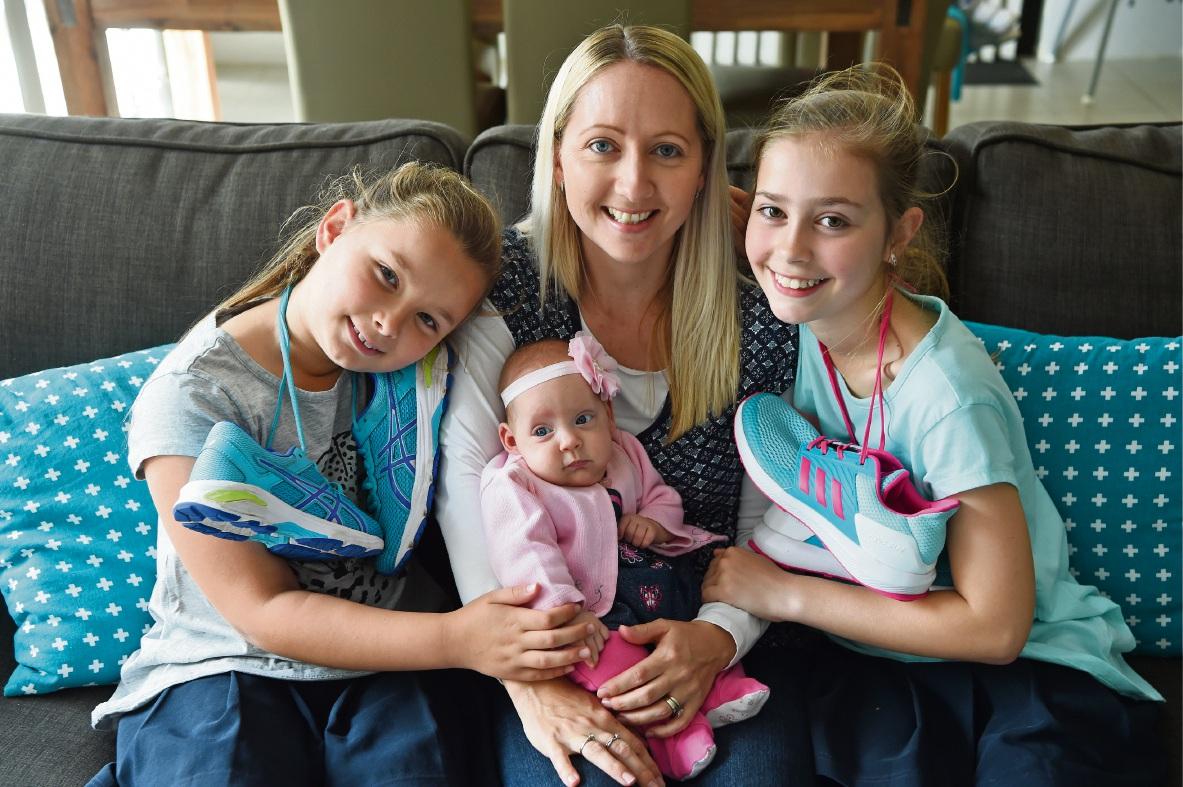 Amy Fairman with Kayla (8, left), baby Matilda and Ella (10). Picture: Jon Hewson www.communitypix.com.au   d474757