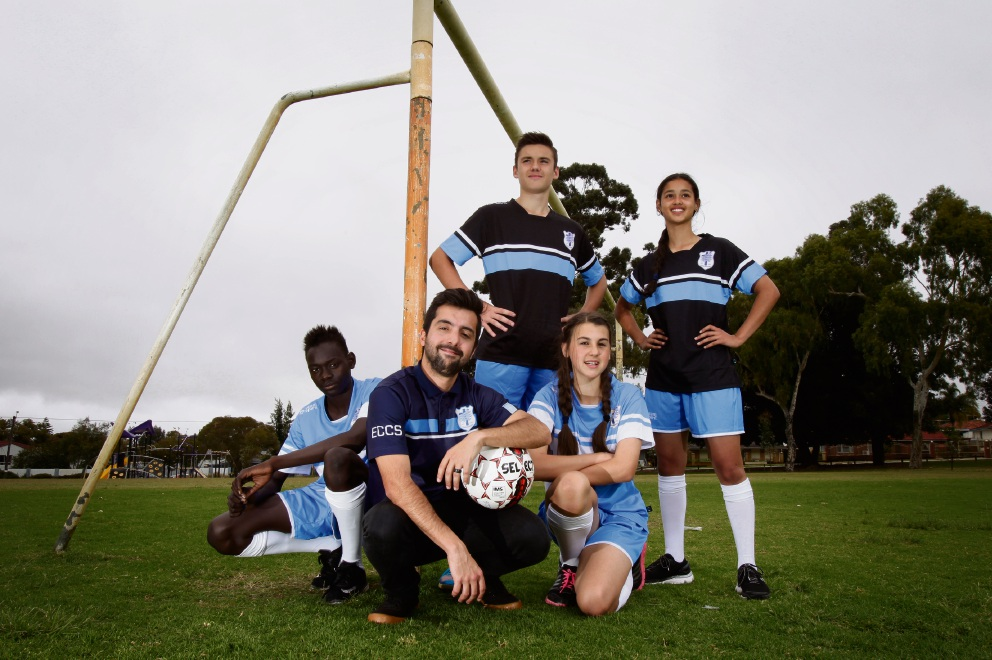 Coach Will Cruz, centre, with students Taban Lado (14), Nic Borbil (15), Victoria Pavkovic (13) and Delene Manuel (14), wearing their new kit.  d474142