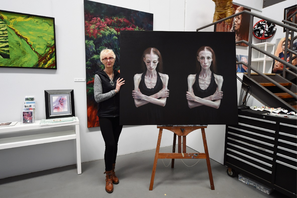 Artist Jana Vodesil-Baruffi with her Black Swan nominated portrait of her neighbour Paige. Picture: Jon Hewson www.communitypix.com.au   d474962