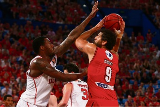 Matt Knight looks to put a shot up against Delvon Johnson of the Illawarra Hawks in one of his last games for the Wildcats. Picture: Getty Images
