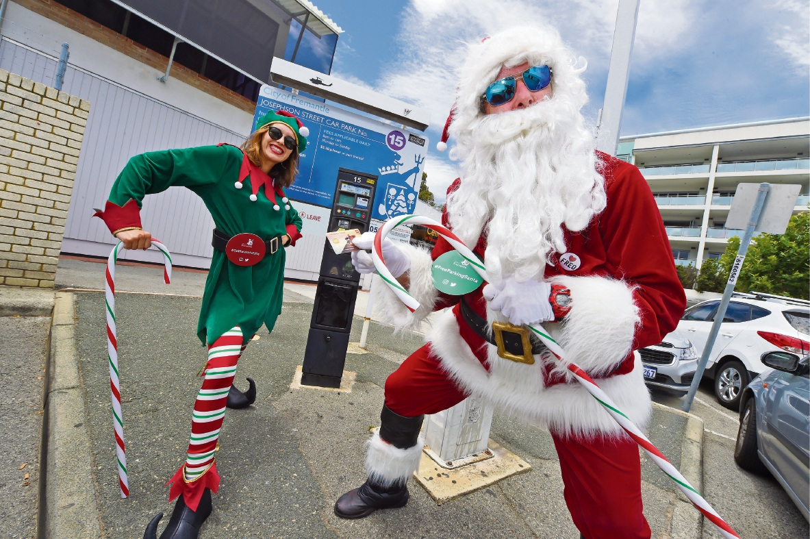 'Elfie' Lily Stewart and Santa Andy Fraser. Picture: Jon Hewson