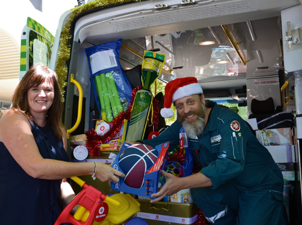 Debbie Moss, senior child protection worker at the Department of Communities, and St John Ambulance paramedic Hans Deberitz with some of the gifts.