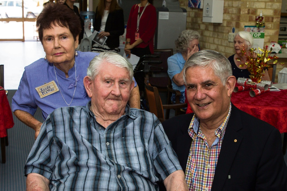Josee Mather behind the chair of 100-year-old resident John Foley with Aged Care Minister Ken Wyatt at Jeremiah Donovan House.