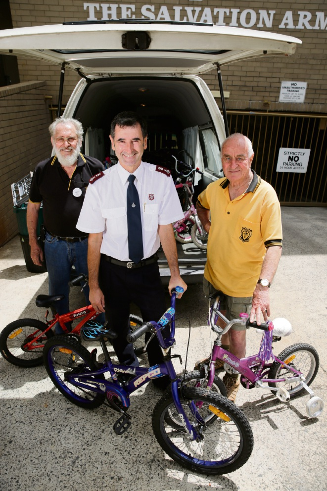 Dave Weeks (The Vintage Motor Cycle Club of WA), Major Paul Hatleley (Salvation Army) and Adrian White (The Vintage Motor Cycle Club of WA President). Picture: Andrew Ritchie d477598