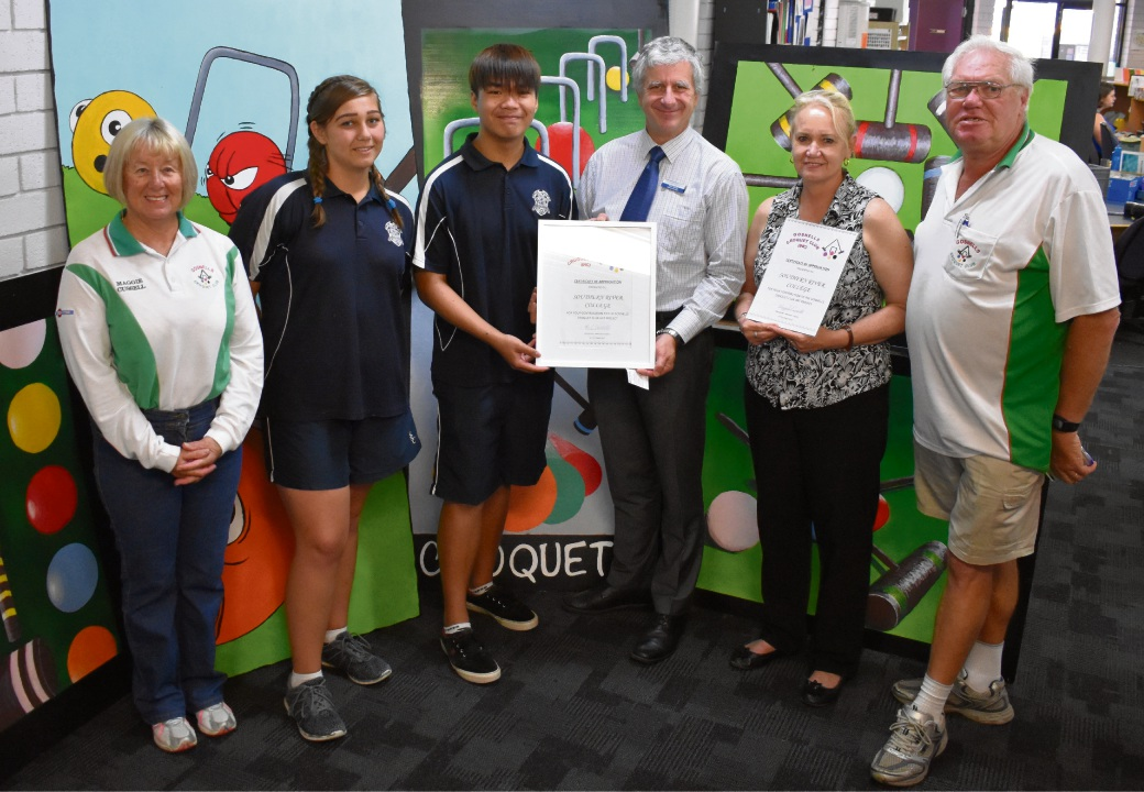 (L-R) Croquet club president Maggie Cussell, Katarina French (Year 9) Aaron Javier (Year 9) vice principal Mike Erith, art teacher Gayle Page and vice-president Terry Brown.