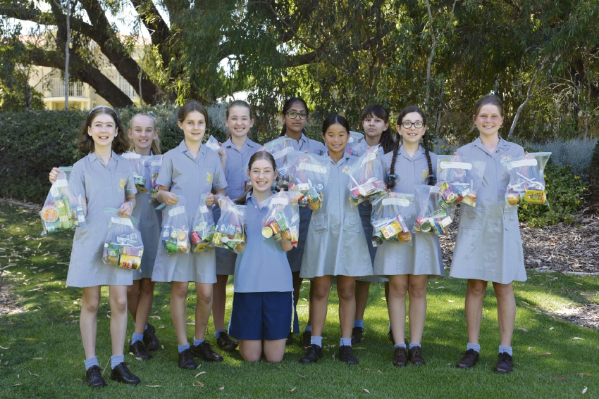 Annabelle Elias (centre) with the Junior School Community Service Committee.