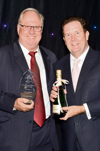 Angus Raine (right) presents Peter Vetten with one of many awards for Raine & Horne Mandurah.