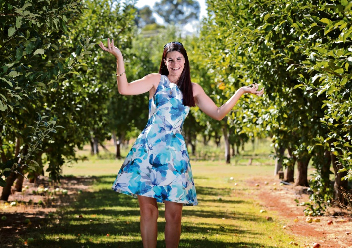 She's apples: Bernadine Radice picking granny smiths at her family-owned business. Picture: David Baylis    d480902