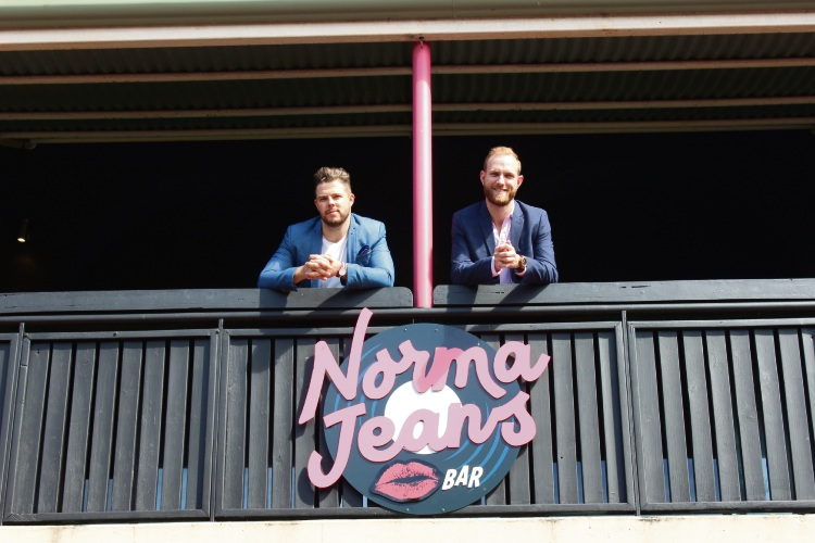 Norma Jeans Venue Manager Ethan Male with Head of Marketing Scott Pattrick on the balcony of Mandurah's Norma Jeans club.