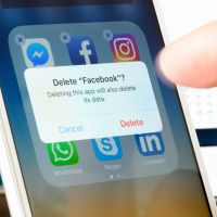 Antibes, France - February 22, 2018: User deletes Facebook app from iPhone. The social media platform faces increased scrutiny around personal data privacy and its handing of fake news and extremist content.
