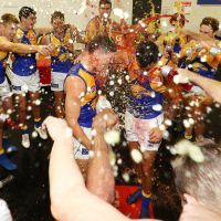 Brayden Ainsowrth and Brendan Ah Chee cop a Gatorade shower after beating GWS on Saturday. Photo: Getty