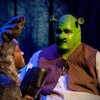 Donkey (Jioji Nawanawa) and Shrek (Nicholas Gaynor) in Shrek.