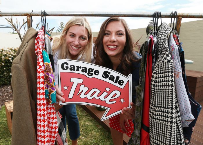 Kate Miles (wardrobe editor and stylist) with Gabby Nuich (long time Garage Sale Trail participant) getting ready for this year's Garage Sale Trail. Picture: Andrew Ritchie.