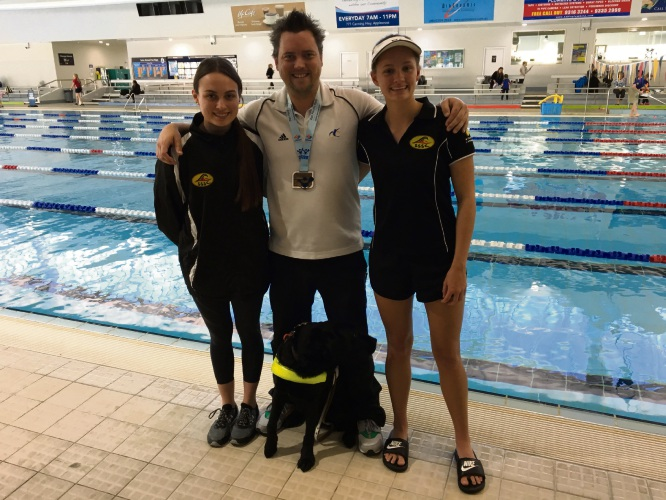 South Shore Swimming Club coach Shannon Doody, Bull Creek swimmer Jeremy McClure with his dog Nina and club member Ellie Fry.