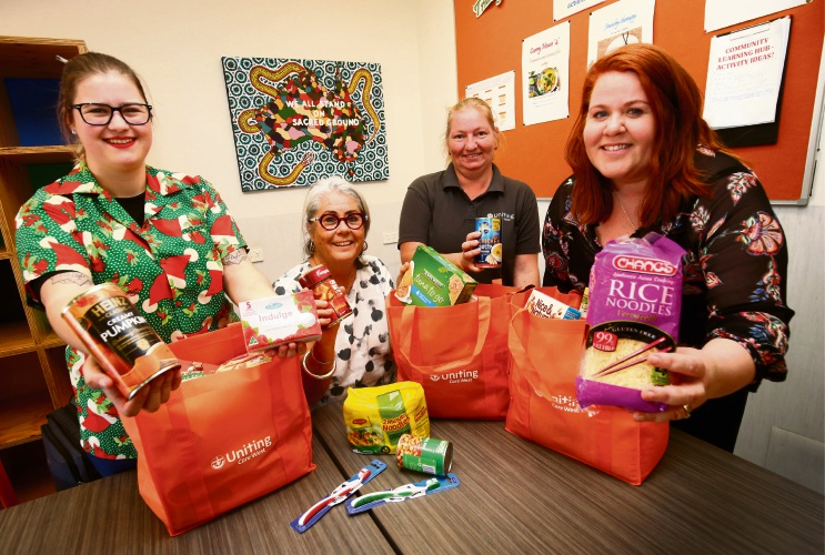 Christmas Appeal coordinator Kate Henning, with support workers Linda Nabben and Natasha Gorman, and Gayle Mitchell. Picture: Matt Jelonek.