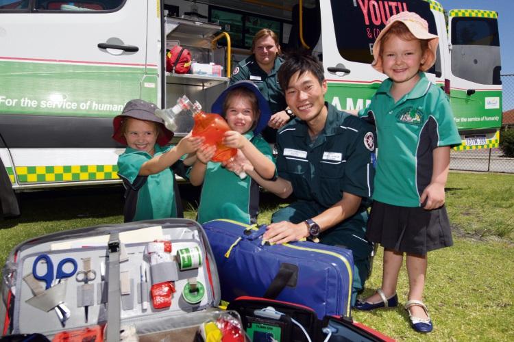 Layla Ware, Lani Holt, Events Ambulance Officer Keita Morimoto and Aliyanah Nelson - looking on is Jordan Campos St John Ambulance volunteer. Picture: Bruce Hunt