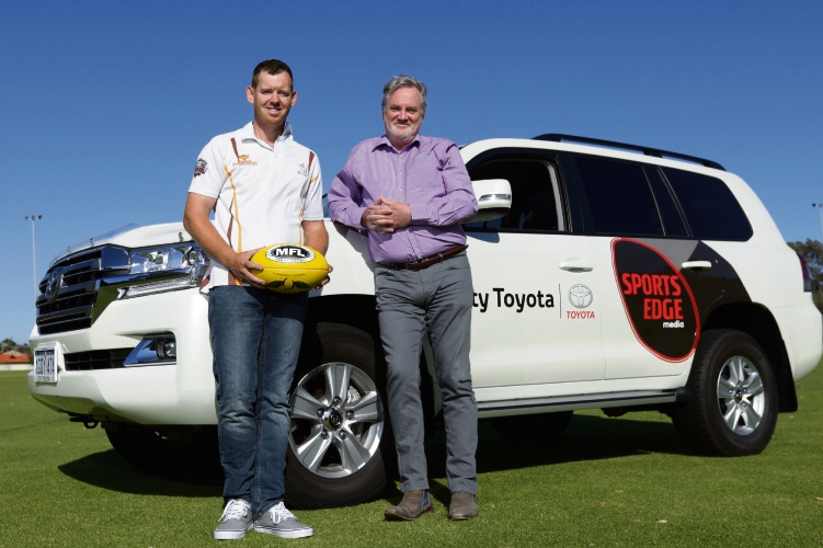 Warwick Greenwood Bulls league coach Jay Carroll and Tom Tapping (CEO Footy Radio). Photo: Martin Kennealey