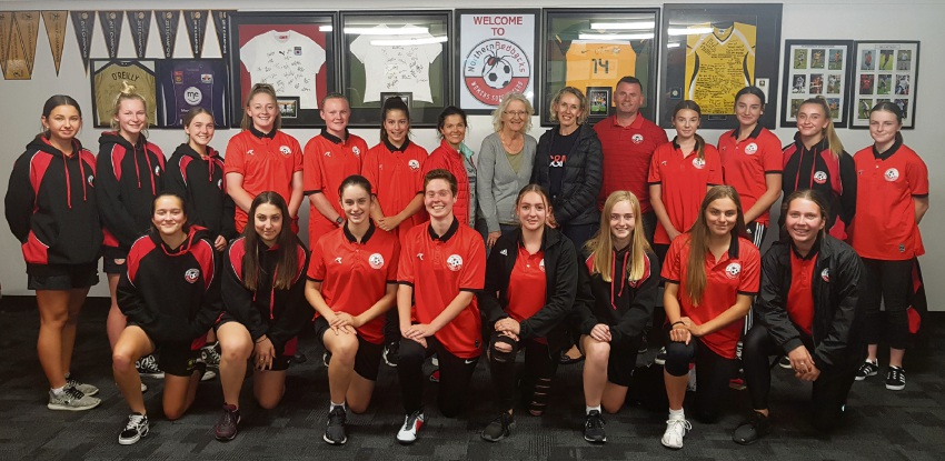 Northern Redbacks' 2019 Gothia Cup squad with their coach and Swedish Women's Educational Association members.