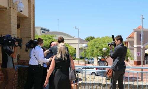 A Joondalup Magistrates Court security guard tries to move on supporters of kangaroo torturer Dylan Griffin. Picture: Anton La Macchia