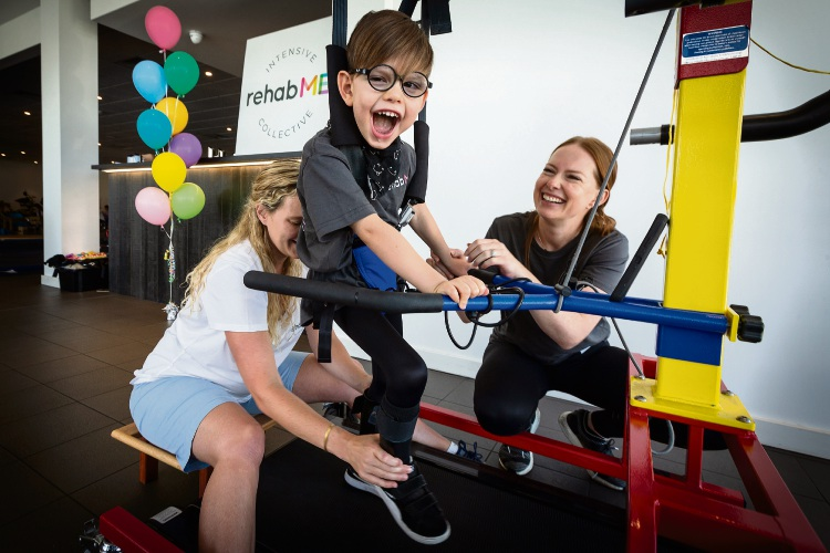 Pictured (L-R) Daisy Stirling (Physiotherapist), Owen Di Candilo,5, Taryn Di Candilo (Duncraig). Photo: Will Russell