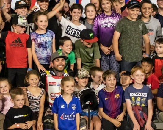 King of the kids: Tai Woffinden gets help to celebrate his second Rob Woffinden Classic.