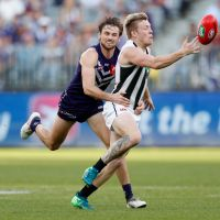 Collingwood's Jordan De Goey is tackled by Fremantle's Joel Hamling during the 2018 AFL round 23 match at Optus Stadium. Picture: Michael Willson/AFL Media/Getty Images