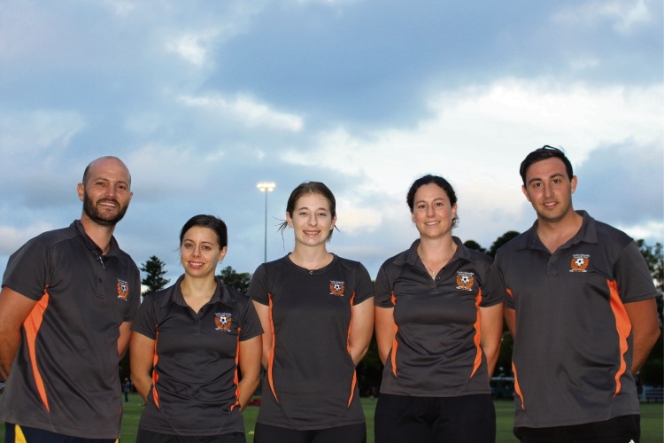 Curtin University FC Women's coaches Dan Jones (far left) and Morrison Dean (far right) with players (L-R) Jemma Garvey, Emily Gurney and Jessica Sheridan. Photo: Ben Smith.