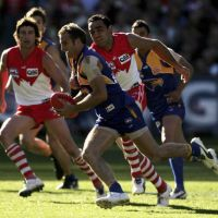 West Coast Eagles captain Chris Judd attempts to break away from Adam Goodes in the 2006 AFL grand final. Picture: Getty Images