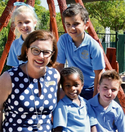Loreto Nedlands principal Therese Hussey and students.