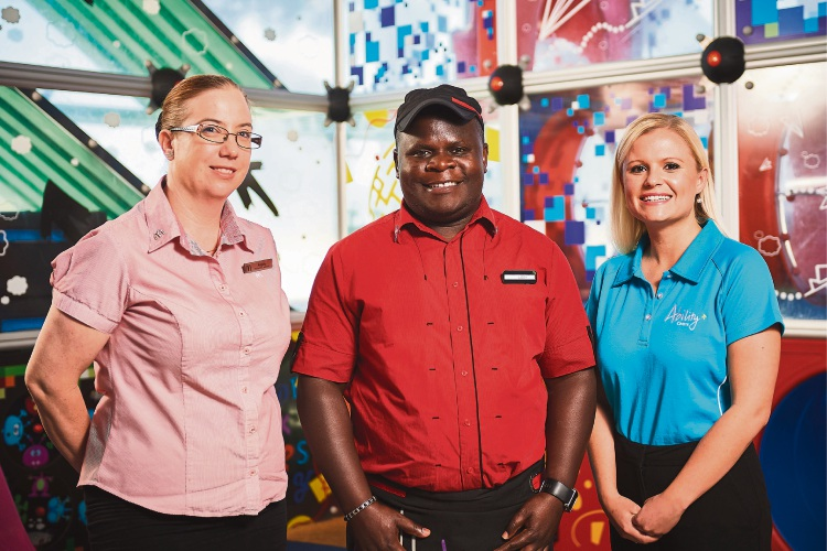 Liddy Ndiwmana (centre) with McDonalds Ballajura manager Angela Haggas (left) and Ability Centre employment coordinator Simone Brussow.