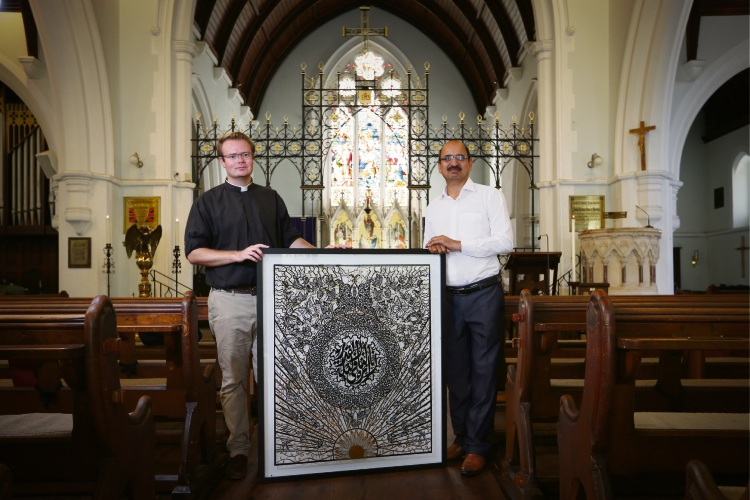 Rev'd Patrick King with Tusif Ahmad (Artist). Photo: Andrew Ritchie. d491837 communitypix.com.au