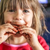 Little girl with a face full of chocolate. Picture: iStock