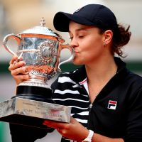 Ashleigh Barty of Australia kisses the trophy as she celebrates victory following the ladies singles final against Marketa Vondrousova of The Czech Republic during Day fourteen of the 2019 French Open at Roland Garros. Picture: Clive Brunskill/Getty Images