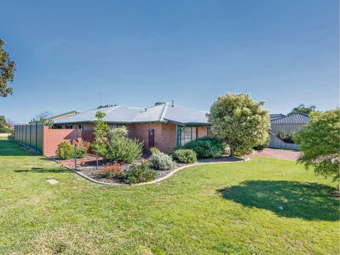There were four bidders at the auction for this home in Elbury Court, Kingsley. It sold under the hammer.
