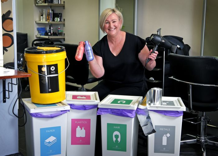 Janine Radford (Owner, Bassendean Hair and Makeup Studio) with her recycling bins in her sustainable hair salon.  Picture: David Baylis.     www.communtitypix.com.au  d495642