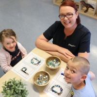 MercyCare Merriwa Early Learning Centre manager Ailish O'Dwyer with Coco (2) and Logan (4).