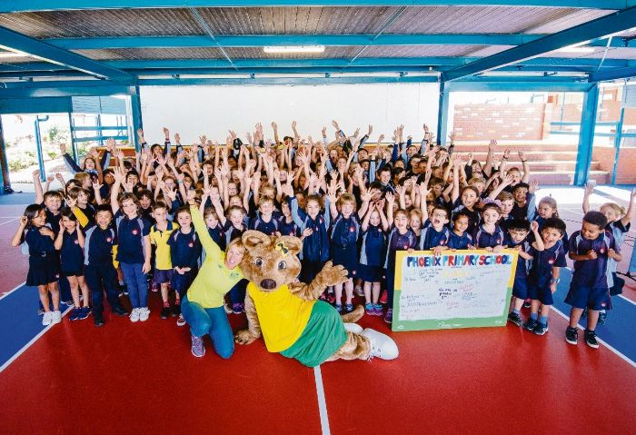 Alicia Molik and the Fed Cup Final mascot opening Phoenix Primary School's new tennis courts. Credit: Damo Photography.