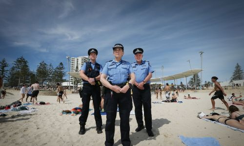 Scarborough Police Constable Josh Hills, Senior Constable Karyn Kersemakers and Senior Sergeant Craig Wanstall at Scarborough Beach. Photo: Andrew Ritchie